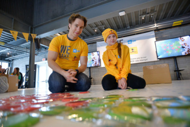 Craig Kielburger, Co-Founder of WE Day and Free The Children with Bella Black, 11 years old, We Bake for Change Ambassador, help the Robin Hood team build the largest cookie mosaic in support of We Bake for Change, an initiative of WE Day. The GUINNESS WORLD RECORDS™ title was made in celebration of Family Day (in Toronto, ON) at Evergreen Brick Works. The completed mosaic measured 29.58 feet by 47.71 feet and was comprised of over 13,000 shortbread cookies. To learn more, visit weday.com/WeBakeForChange. (From left to right: Craig Kielburger, Co-Founder of WE Day and Free The Children with Bella Black, We Bake for Change Ambassador) (CNW Group/Robin Hood)