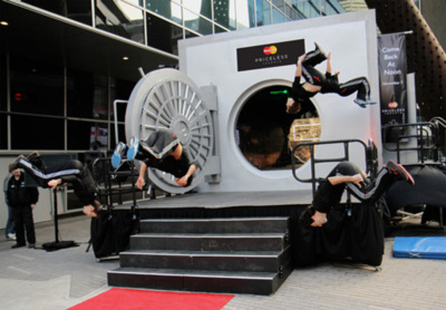 Parkour dancers perform in front of the MasterCard Vault at the #UnlockTO event in Maple Leaf Square. The event kicked off MasterCard Canada's Priceless Toronto program which unlocks priceless city experiences for all cardholders. (CNW Group/MasterCard Canada)