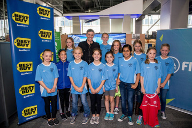 The captain with Vancouver's future stars: Christine Sinclair launched FIFA 16, the first game to feature women in a playable soccer video game, at the downtown Vancouver Best Buy today with lucky members of the North Shore Girls Soccer Club. Published by Burnaby's Electronic Arts studio, FIFA 16 launches September 22, 2015 at local Best Buy stores and BestBuy.ca. Sinclair is featured on the game cover alongside soccer phenom, Lionel Messi. (CNW Group/Best Buy Canada)