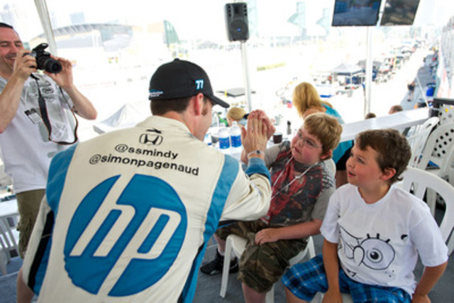 Race car driver Simon Pagenaud celebrates Free Friday with children from Make-A-Wish Canada. Together with race fans, Honda Canada and the Ontario Honda Dealers Association donated $35,000 to Make-A-Wish to help grant wishes of children living with life-threatening illnesses in Canada. (CNW Group/Honda Canada Inc.)