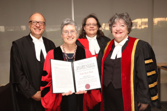 Sheila Block (second to left) holds the degree of presented to her by The Law Society of Upper Canada at its June 24th Call to the Bar ceremony at Roy Thomson Hall. Block is congratulated by CEO Robert Lapper (left), Treasurer Janet Minor (right) and Madam Justice Wendy Matheson, Superior Court of Justice (back). (CNW Group/The Law Society of Upper Canada)