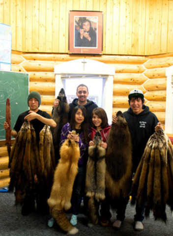 Students at Colville School in Colville Lake, Northwest Territories show examples of fur trapped in the region. (CNW Group/Canadian Northern Economic Development Agency)