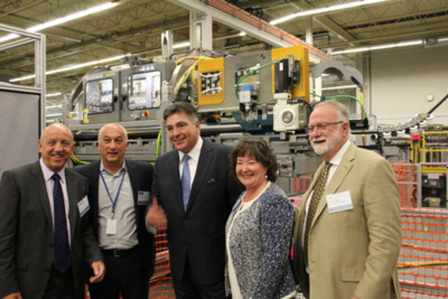 (Left to Right): Duncan Hawthorne, President and CEO, Bruce Power, Anthony Caputo, Chief Executive Officer of ATS Automation, the Honourable Charles Sousa, Ontario's Minister of Finance, Kathryn McGarry, MPP for Cambridge and Doug Craig, Mayor of Cambridge share in the unveiling of the Bruce Reactor Inspection and Maintenance System (BRIMS) tool at ATS Automation in Cambridge, Ontario, Thursday. BRIMS will allow for more effective execution of inspection and maintenance activities at Bruce Power, which provides 30 percent of Ontario's electricity. (CNW Group/ATS Automation Tooling Systems Inc.)