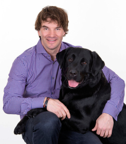 Nicolas St-Pierre and his dog Roger (CNW Group/MIRA FOUNDATION)