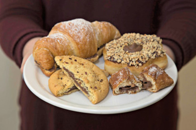 Beginning March 9, 2016, for a limited time, baked goods with Nutella® will once again be available at Tim Hortons, including the new Croissant and Cookie filled with Nutella® and returning Chocolate Hazelnut Donut and Pastry Pockets filled with Nutella®. (CNW Group/Tim Hortons)