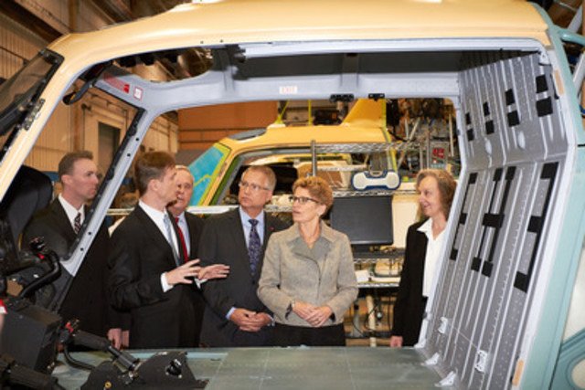 Ontario Premier Kathleen Wynne, Economic Development for Southern Ontario Minister Gary Goodyear and Airbus Helicopters Canada CEO Romain Trapp inspect a helicopter in production at the company's Fort Erie ON plant where 40 new high-skill jobs are being added to produce helicopter engine cowlings for the global market. (CNW Group/Airbus Helicopters Canada)