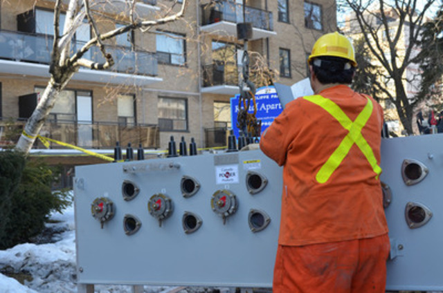 New electrical switchgear is being prepared for installation into an underground vault. The process is complicated and customers in the Thorncliffe Park area have been without power for over 24 hours. This equipment dates back to the former East York Hydro and today, its replacement is worth about $65,000. Crews will continue to work until power is restored. (CNW Group/Toronto Hydro Corporation)