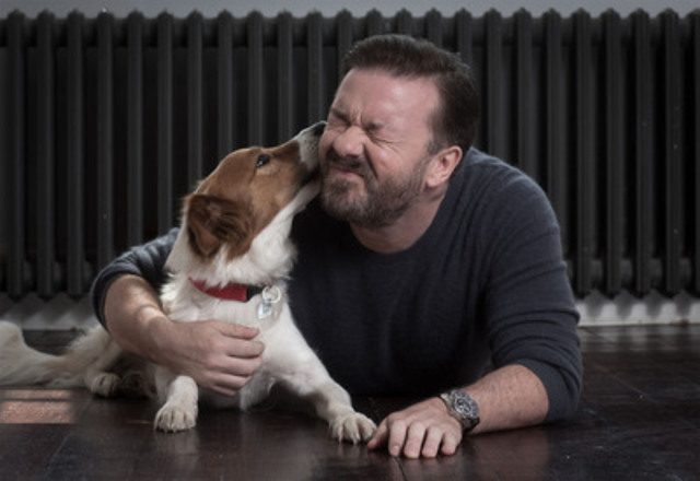 Actor, writer and comedian Ricky Gervais has given support to WSPA on several campaigns. Here Gervais, with rescue dog Barney, is helping WSPA spread the word about the Collars Not Cruelty campaign. (CNW Group/World Society for the Protection of Animals)