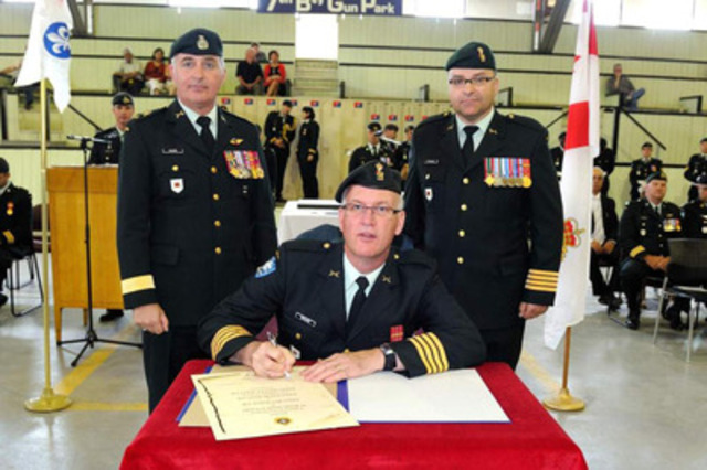 From left to right: the commander of the Land Forces Quebec Area/Joint Task Force (East), Brigadier-general Richard Giguère, The previous commander, Colonel Marc Richard, the new commander, Colonel Luis De Sousa. (CNW Group/National Defence)