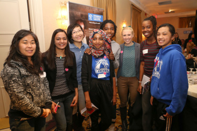 Three of Plan Canada's Top 20 Under 20 award winners, Maya Burhanpurkar (second from left), Jeanny Yao (third from left), and Jessie MacAlpine (third from right), joined more than 400 girls from Toronto to celebrate International Women's Day at an inspiring event hosted by Plan Canada and the Toronto District School Board on March 4. Photo: Angie Ramos/Plan Canada  (CNW Group/Plan Canada)