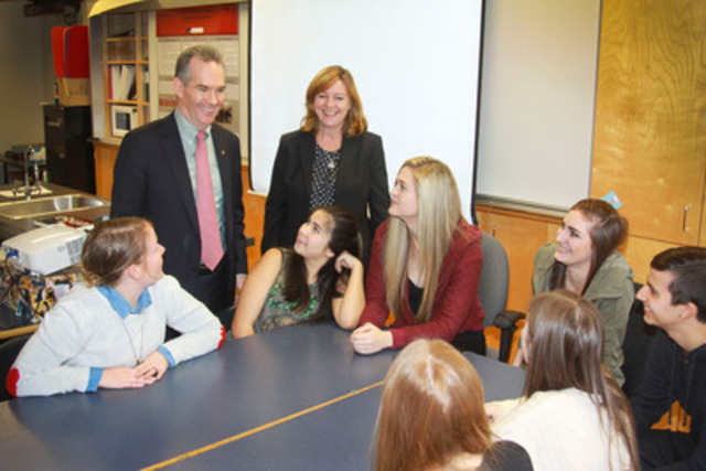 "Surrey, BC - As part of Financial Literacy Month, Graham MacLachlan (RBC Regional President, BC - standing left), Jane Rooney (Canada's Financial Literacy Leader - standing right), teacher Sarah Daintrey (seated left) and students of Clayton Heights Secondary School discuss the ""It All Adds Up"" curriculum. (CNW Group/RBC)"