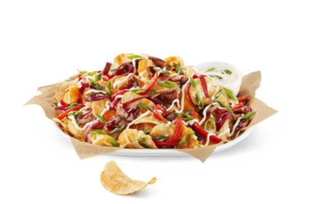 Boston Pizza's most popular sharable item, Cactus Cut Potatoes are being reinvented and can now be enjoyed as nachos. Packed with all the major nacho fixings, the new Cactus Cut Nachos will be available in two flavours - Cheesesteak and Spicy Perogy. (CNW Group/Boston Pizza International Inc.)