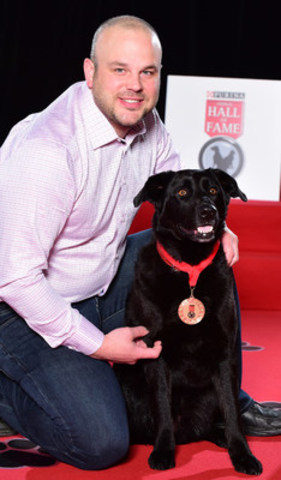 Brent Cote's heroic dog, Raya, was inducted today into the 2016 Purina Animal Hall of Fame for saving him and his mother Trudy from an aggravated bear. (CNW Group/Nestle Purina PetCare)