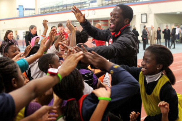 Olympian Justyn Warner celebrates with local school children at the CIBC Pan Am and Parapan Am Athletics Stadium groundbreaking at York University on Monday, November 19, 2012. THE CANADIAN PRESS IMAGES /Chris Young (CNW Group/Toronto 2015 Pan/Parapan American Games)