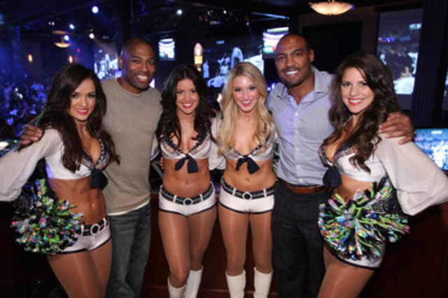 Former NFL Players Shaun Alexander (left) and Darren Woodson join members of the Sea Gals at Vancouver's Official Super Bowl XLVII Party hosted by the NFL and presented by Bud Light. (CNW Group/Mosaic Sales Solutions)