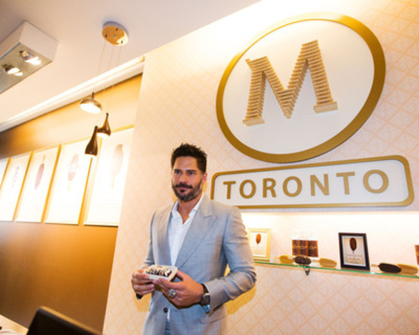 Actor Joe Manganiello with his custom created Magnum ice cream bar at Toronto's Magnum Pleasure Store on July 4th, 2013 in Toronto, Canada (CNW Group/Magnum)