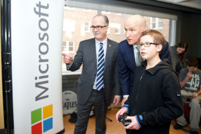 Tobin Haas, SickKids patient ambassador, tests the new Xbox One with Michael Hilliard (Senior Corporate Counsel , Microsoft Canada) and John Hartman (Chief Operating Officer, Children's Miracle Network) at The Hospital for Sick Children (SickKids). Microsoft Canada, with Children's Miracle Network, presented its CLICK donation at the hospital today. (CNW Group/Microsoft Canada Inc.)