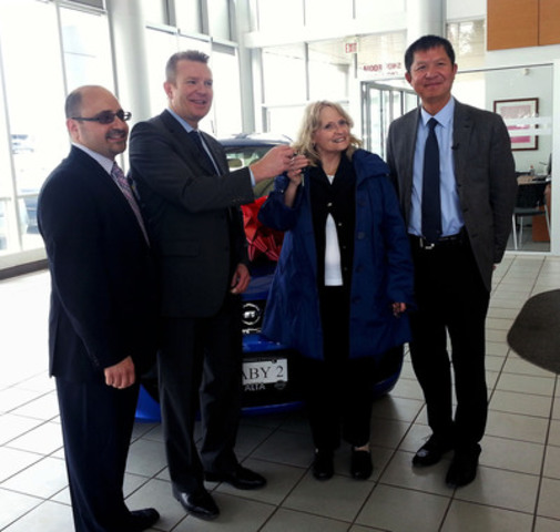 From left-to-right: Gabriel Paniccia, general manager at Alta Nissan, Christian Meunier, president of Nissan Canada Inc., Karen Ackroyd customer of Alta Nissan, and Edward Wong, principal owner Alta Nissan in front of Karen's new 2015 Nissan Micra. (CNW Group/Nissan Canada Inc.)