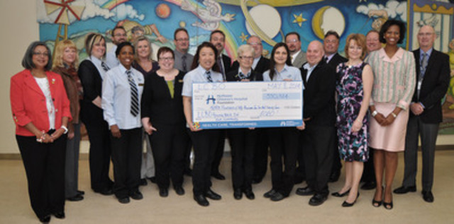 LCBO representatives celebrate the generosity of customers and staff who raised $350,524  for McMaster Children's Hospital Foundation, including Pearl Veenema, President and CEO, Hamilton Health Sciences Foundation (far left), and Dr. Peter Fitzgerald, President, McMaster Children's Hospital (far right), as part of the 2013 Giving Back in Our Community campaign. (CNW Group/LCBO)