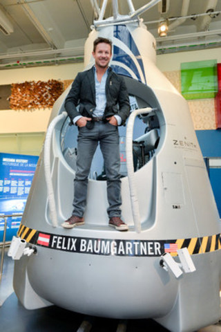 Austrian pilot Felix Baumgartner stands on the capsule used for his historic freefall on October 14, 2012 and now on show at the Ontario Science Centre. The Red Bull Stratos exhibit explores highlights the equipment used in the mission and runs at the Science Centre until January 11, 2016. (CNW Group/Ontario Science Centre)