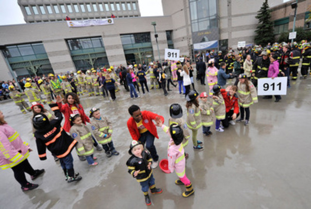 High-fives all around as kids and firefighters celebrate Fire Prevention Week (CNW Group/City of Barrie)