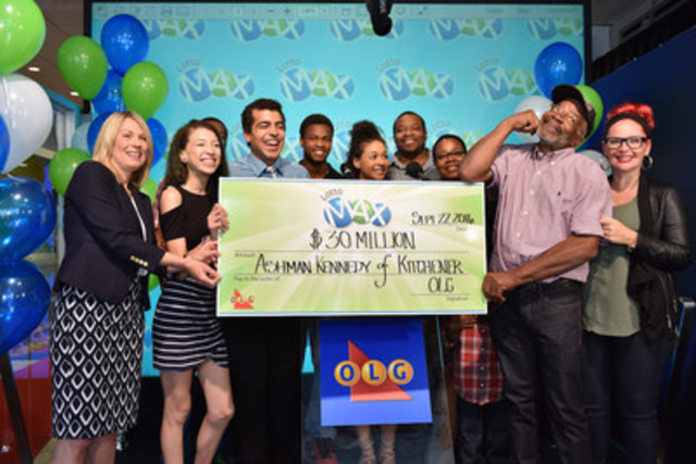 OLG's Vice President of Lottery Marketing and Sales Wendy Montgomery presents Kitchener resident Ashman Kennedy with a cheque for $30,000,000 at the OLG Prize Centre Thursday. Ashman won the September 16, 2016 LOTTO MAX jackpot. (CNW Group/OLG Winners)