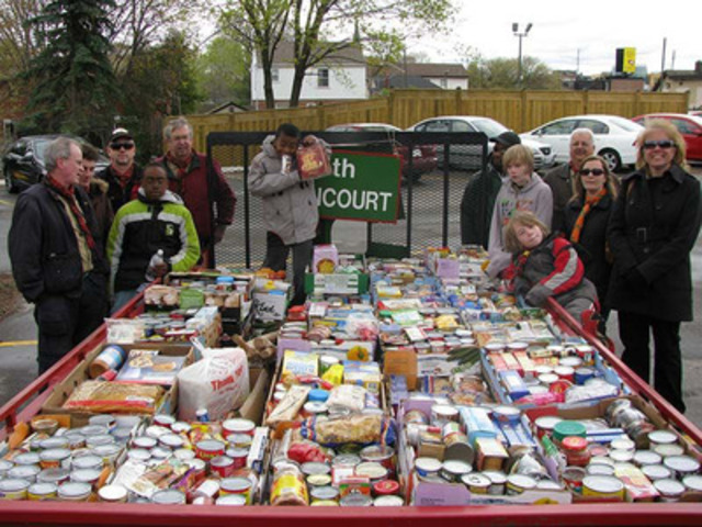 "Toronto Scouts hit the streets with their ""Hike for Hunger"" parade during Good Turn Week 2014, collecting enough food donations for the local food bank to fill two 6' x 12' trailers to maximum capacity. (CNW Group/Scouts Canada)"