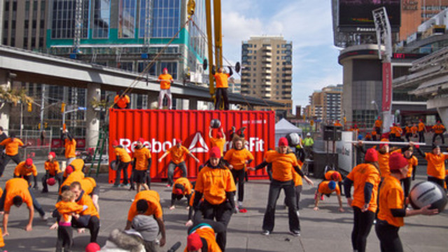 The box has dropped! A flash mob of 250 CrossFitters descend on Yonge and Dundas square for the launch of Reebok CrossFit today in Toronto. (CNW Group/CNW Broadcast Services)