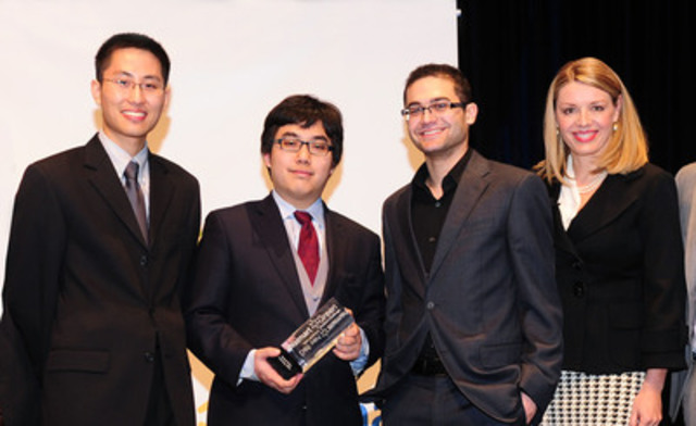 Shelley Broader, president and CEO of Walmart Canada, congratulates Michael Zhang, Adam Wang and Andrew Girgis ...