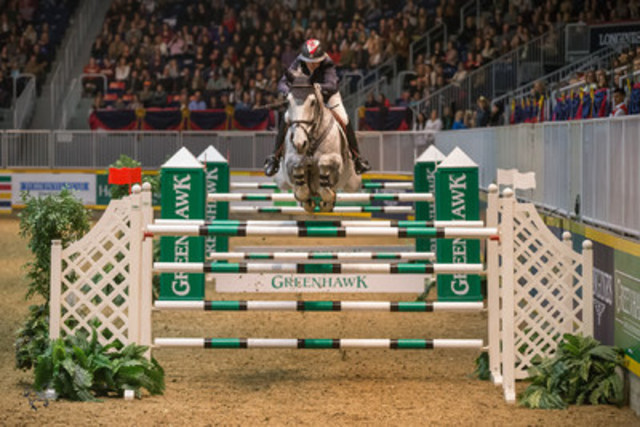 """Jill Henselwood and Farfelu du Printemps, owned by John Madigan, won the $100,000 Greenhawk Canadian Show Jumping Championship at the 2015 Royal Horse Show® on Saturday, November 7.""  (CNW Group/Royal Agricultural Winter Fair)"