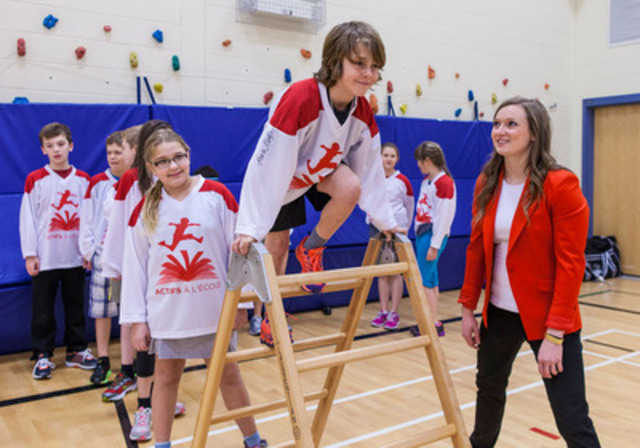 Olympic Gold Medalist Rosie MacLennan plays with local Fredericton students at the launch of the Premier's Challenge, a program designed to get kids ACTIVE AT SCHOOL. (CNW Group/ACTIVE AT SCHOOL)