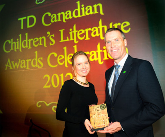 Tim Hockey (right), President and CEO, TD Canada Trust, presents Toronto author Trilby Kent (left) with the TD Canadian Children's Literature Award and $30,000, the largest prize in Canadian children's literature, for her powerful novel, Stones for my Father (Tundra Books), at the Ritz-Carlton Hotel. (CNW Group/TD Bank Group)