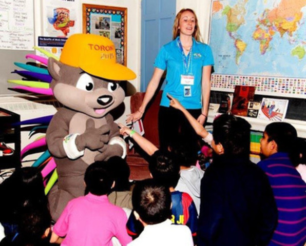 TORONTO 2015 Pan Am/Para Pan Am Games mascot PACHI and Olympian Rosie Cossar help launch The PrideHouse That Kids Built with elementary students. (CNW Group/PrideHouse Toronto)