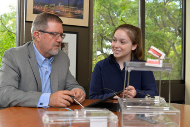 2016 Weston Youth Innovation Award recipient Emma Mogus shows Dr. Maurice Bitran, CEO and Chief Science Officer, Ontario Science Centre, her invention: the Tongue-Interface-Communication (TiC), a tongue-controlled computer mouse to enable those with physical impairments to communicate freely and effectively online. (CNW Group/Ontario Science Centre)