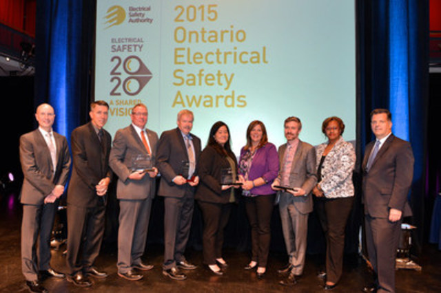 L-R: David Collie, President & CEO, Electrical Safety Authority, Scott Saint, Chief Public Safety Officer, Electrical Safety Authority, Ken Walsh, Chief Engineer and VP Operations, London Hydro, Steve Hibbert, Director of Energy & Building Services, Toronto2015, Cynthia Tetaka, Manager, Corporate Communications, Hydro One Networks Inc., Lisa Williamson, VP, Health & Safety Environment, Hydro One Networks Inc., Brian Buchan, Director of Media, Communications and Municipal Stakeholder Relations, Toronto Hydro, Deputy Minister Angela Coke, Ministry of Government & Consumer Services, Brian Bentz, Chair of the Board, Electrical Safety Authority (CNW Group/Electrical Safety Authority)