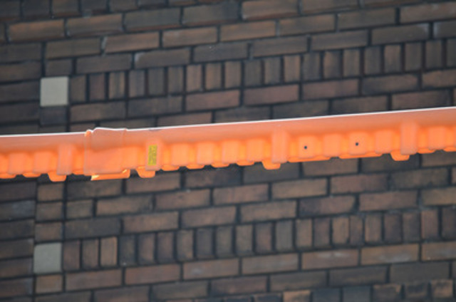 Although unsightly, these orange, highly visible powerline covers help keep Torontonians safe from overhead powerlines and are mandatory by law. (CNW Group/Toronto Hydro Corporation)