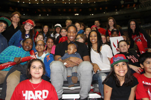 DeMar DeRozan and Kiara Morrison celebrate St Jane Frances Catholic School's grade 5 class, winners of DeMar DeRozan All Star Book Program (Photo Credit: Jacqueline Khalil) (CNW Group/Indigo Books & Music Inc.)