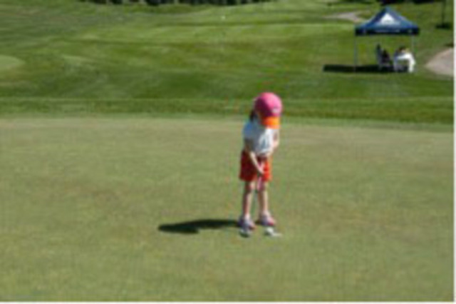 Three-year-old Wish Child Paulena is having some fun on the green. She was diagnosed with Osteogenesis Imperfecta, and her wish is to go to Disney World. (CNW Group/The Children's Wish Foundation of Canada)
