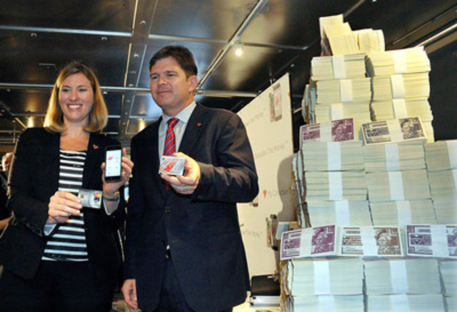 Carol Deacon, SVP of Loyalty and Digital at Canadian Tire, left, and Allan MacDonald, COO of Canadian Tire, unveil the next evolution of Canadian Tire's loyalty program, My Canadian Tire 'Money', during a news conference in a bank vault in Toronto, September 9, 2014.  My Canadian Tire 'Money' is a game changer. Whether customers are loyal or occasional visitors, the new program will undoubtedly drive sales, store traffic and repeat visits. #MyCTMoney THE CANADIAN PRESS IMAGES/J.P. Moczulski (CNW Group/CANADIAN TIRE CORPORATION, LIMITED)