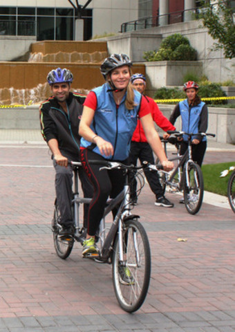Lauren Wilkinson, Olympic Silver Medalist, Women's Rowing, 2012 London Summer Olympics and City TV's Riaz Meghji put the pedal-to-the-pavement as part of the Clean Air Champions Celebrity Tandem Bike Race in Vancouver. (CNW Group/Clean Air Champions)