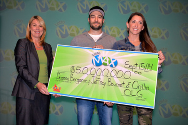 Caption: Orillia residents Deanna Bergeron (R) and Jeff Bourret (M) are presented a cheque for $50,000,000 by OLG's Vice President, Marketing and Sales, Wendy Montgomery at the OLG Prize Centre on Monday, September 15, 2014. Deanna and Jeff won the September 5, 2014 LOTTO MAX jackpot. (Photo Credit: Shan Qiao) (CNW Group/OLG Winners)