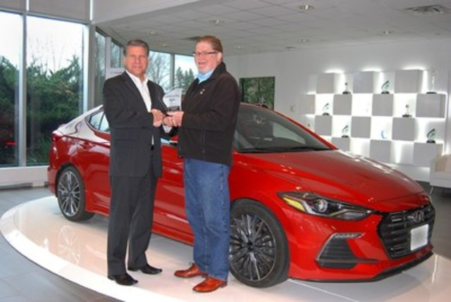 BEST NEW SPORTS / PERFORMANCE CAR Hyundai Elantra (Sport), with 682 points, and scoring highest in Occupant Environment and Ride Dynamics. 2nd place Ford Focus RS with 670 points. 3rd place Fiat 124 Spider with 637 points. (Left: Don Romano, President and CEO, Hyundai Auto Canada Corp., Right: David Taylor, CCOTY Committee Member) (CNW Group/Automobile Journalists Association of Canada)