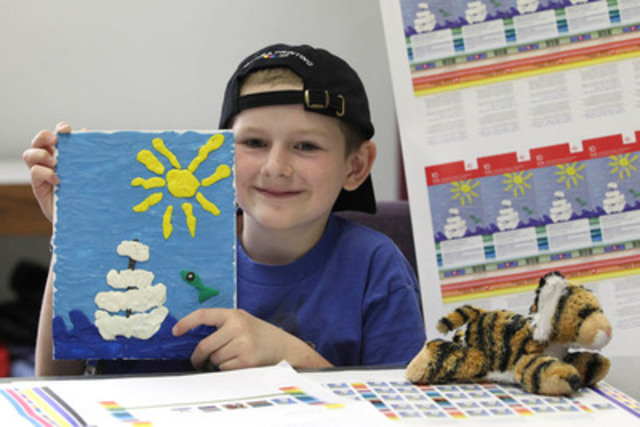 Stamp design competition winner, Ezra Peters of Whitelaw (Alberta), poses with his creation now on three million semi-postal stamps that will help support the work of non-profit children's charities and school programs across the country. (CNW Group/Canada Post)