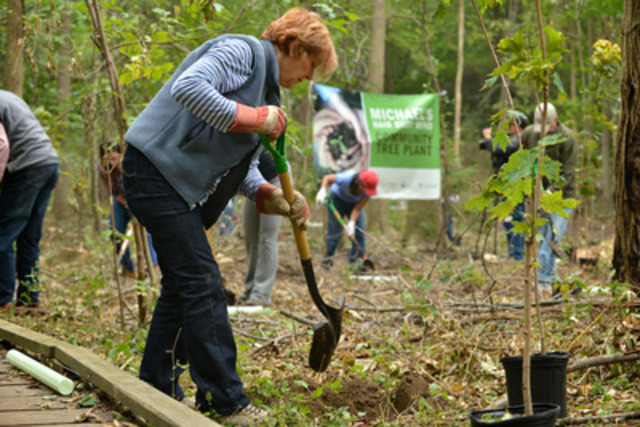 Michael's Hair Body Mind salon owner Lina Morra-Lomangino planted trees today in Rattray Marsh, an area devastated by Emerald Ash Borer. (CNW Group/Trees Ontario)