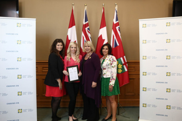 Canadian Cancer Society staff members Florentina G. Stancu-Soare (left) and Joanne Di Nardo (right) stand with volunteer Kate Neale and Health Minister Deb Matthews. (CNW Group/Canadian Cancer Society (Ontario Division))