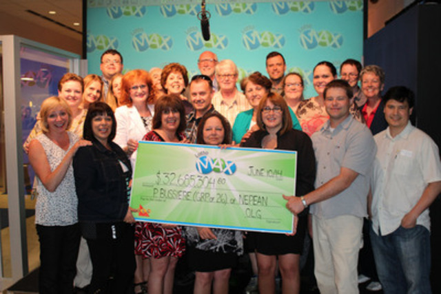 Group of 26 co-workers from Ottawa share the $32.6 million jackpot from the June 6, 2014 LOTTO MAX draw (CNW Group/OLG Winners)