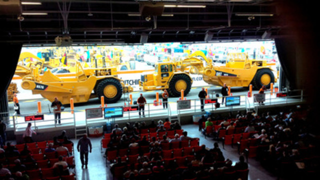 A selection of motor graders is sold on the ramp for US$565,000 each - Day One of the Ritchie Bros. record-breaking unreserved auction in Las Vegas, NV last week (US$60+ million on March 6 & 7, 2014) (CNW Group/Ritchie Bros. Auctioneers)