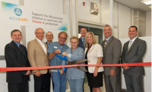L to R: Martin Quesnel, Bev Shipley M.P., Colin McClintock, Eric Erickson & Brenda Brown, Scott McRorie, Christina Dendys, Bruno Biscaro, Tom Hawkeswood at the Accucaps vitamin A production kick-off ribbon cutting ceremony. (CNW Group/Accucaps Industries Limited)