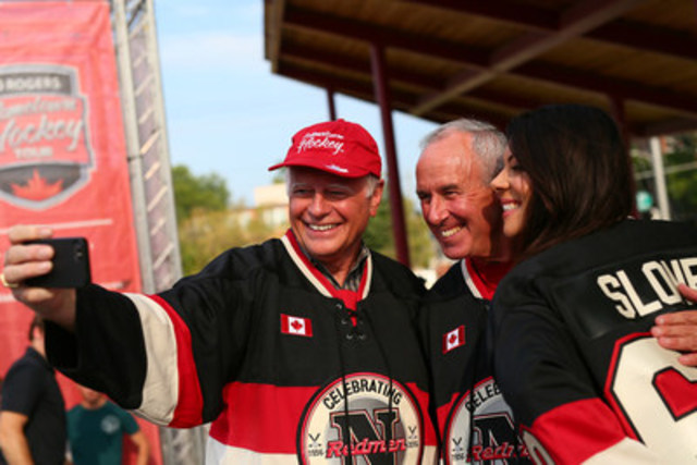 Mayor Tony Van Bynen of Newmarket, ON and Rogers Hometown Hockey co-hosts Ron MacLean and Tara Slone celebrate the launch of Year 3 of Rogers Hometown Hockey, kicking off in Newmarket, Oct. 15-16. (CNW Group/Rogers Communications Inc.)