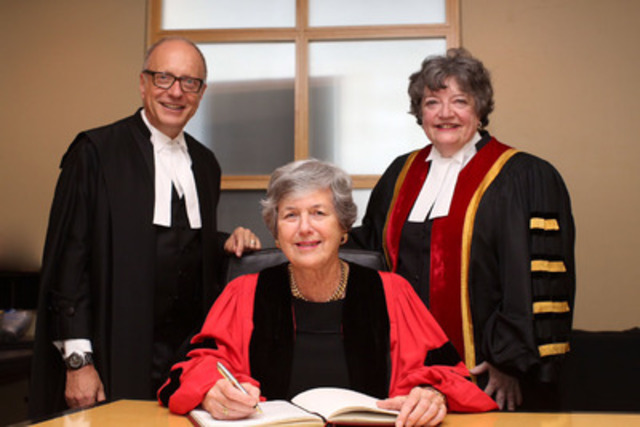 The Law Society of Upper Canada presented an honorary LLD to London lawyer Janet E. Stewart, QC, OOnt., (seated), at the June 18 Call to the Bar ceremony in London. Law Society Treasurer Janet E. Minor (right) and CEO Robert G.W. Lapper, QC, congratulate her as she signs the LLD register. Stewart was honoured for her leadership and contributions throughout her distinguished career as a respected mentor and an advocate for the advancement of women in law. (CNW Group/The Law Society of Upper Canada)